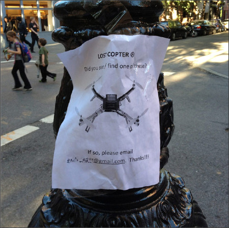 http://kottke.org/13/09/sign-of-the-times-a-lost-drone-poster