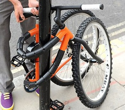 http://gizmodo.com/5582565/this-bendable-bike-can-tie-itself-to-a-lamp-post