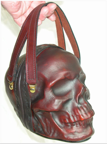 http://www.etsy.com/listing/86827402/leather-skull-purse-clutch-in-oxblood