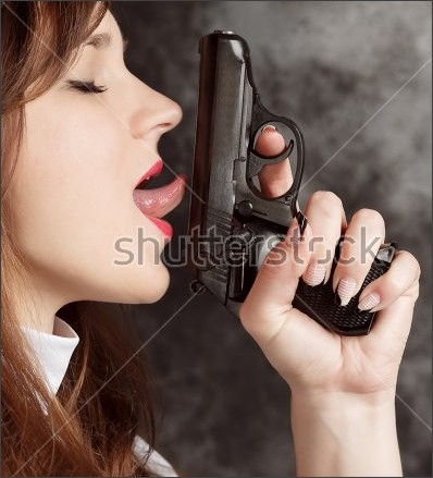 https://thumb9.shutterstock.com/display_pic_with_logo/3631139/515459752/stock-photo-attractive-nun-with-a-gun-in-his-hand-on-a-dark-background-close-up-side-view-of-a-woman-licking-a-515459752.jpg
