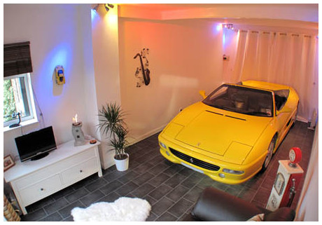 http://swns.com/living-vroom-ferrari-fan-parks-car-in-lounge-201035.html