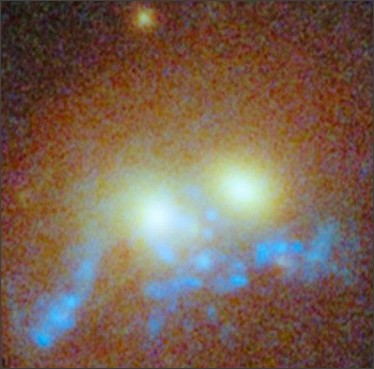 http://www.dailygalaxy.com/my_weblog/2014/07/colossal-bridge-of-stars-found-linking-giant-emerging-elliptical-galaxies.html