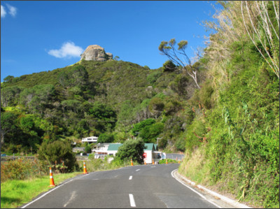 https://nzfrenzynorth.files.wordpress.com/2013/01/approaching-whangaroa-with-st-pauls-rock-presiding-over-th-village.jpg