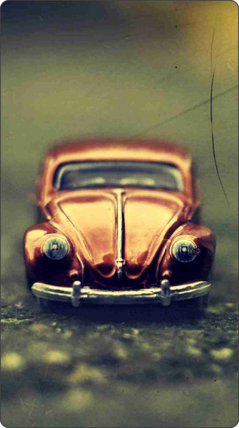 http://www.ilikewallpaper.net/iphone-5-wallpaper/Volkswagen-Beetle-Toy/5121