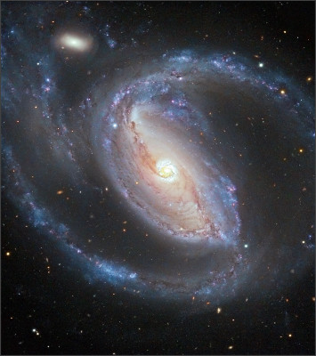 http://annesastronomynews.com/wp-content/uploads/2012/02/Arp-77-NGC-1097-a-barred-Seyfert-spiral-galaxy-and-NGC-1097A-the-small-elliptical-companion-about-50-million-light-years-away-in-Fornax-have-been-interacting-in-the-recent-past.jpg