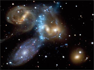 https://upload.wikimedia.org/wikipedia/commons/1/15/Stephan%27s_Quintet_X-ray_%2B_Optical.jpg