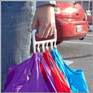 http://www.organize.com/the-baggler-reg-bag-carrier.html