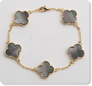 http://www.etsy.com/listing/150285738/vintage-alhambra-style-bracelet?ref=usr_faveitems
