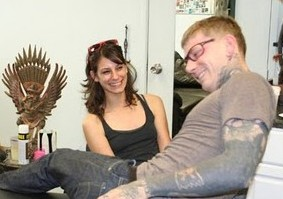 http://damncoolpics.blogspot.com/2010/01/guy-gets-eyeglasses-tattooed-on-his.html