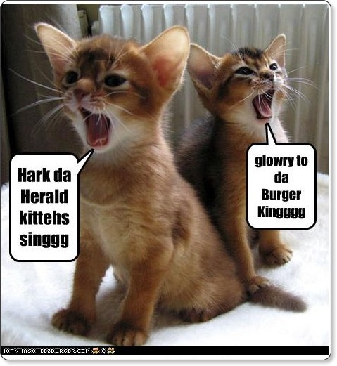 http://icanhascheezburger.com/2009/12/16/funny-pictures-herald-kittehs-singgg/