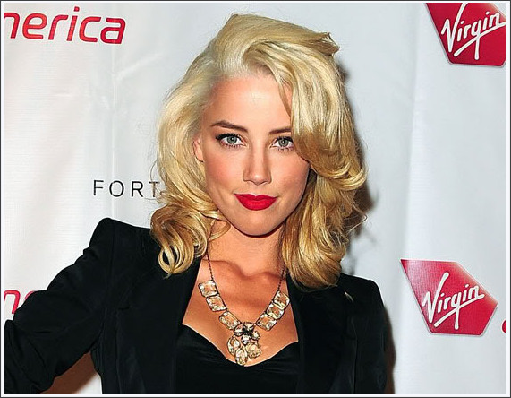 http://www.moejackson.com/2009-amber-heard-virgin-america-launch-party-1119