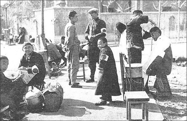 http://commons.wikimedia.org/wiki/File:Barbershop_in_Nanking1937.jpg